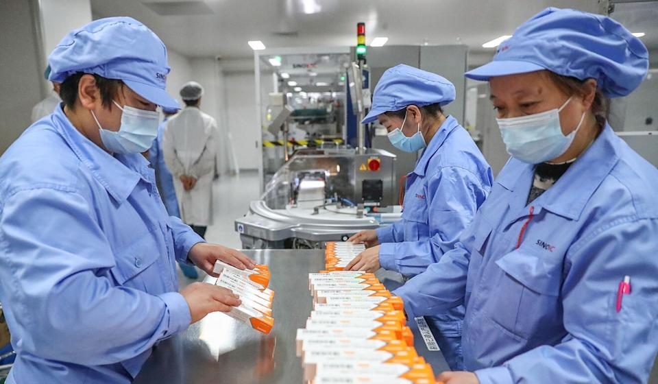 Sinovac employees work at a Covid-19 vaccine packaging plant on January 6. Photo: Xinhua