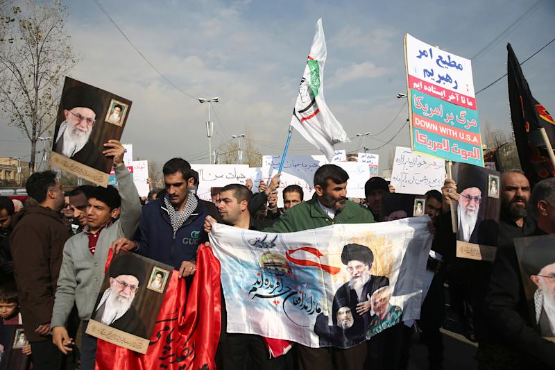 Demonstrators hold pictures of Iran's Supreme Leader Ayatollah Ali Khamenei during a protest against the assassination of the Iranian Major-General Qassem Soleimani, head of the elite Quds Force, and Iraqi militia commander Abu Mahdi al-Muhandis who were killed in an air strike in Baghdad airport, in Tehran, Iran January 3, 2020. WANA (West Asia News Agency)/Nazanin Tabatabaee via REUTERS ATTENTION EDITORS - THIS IMAGE HAS BEEN SUPPLIED BY A THIRD PARTY.