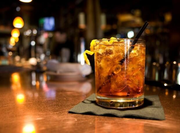Is the bitter, complex negroni the perfect pandemic cocktail? It's certainly up there, says Mackenzie Irvine, normally a bartender at Ottawa's Riviera restaurant. (Lucy Sherman/AP - image credit)