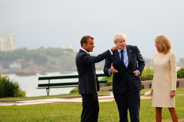 """Johnson said he didn't want to get into """"any post-Brexit eschatology"""" with Donald Tusk before touching down in Biarritz where he was welcomed by French President Emmanuel Macron and his wife Brigitte"""