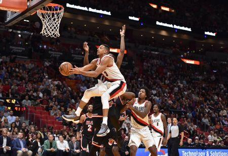Dec 13, 2017; Miami, FL, USA; Portland Trail Blazers guard CJ McCollum (3) shoots the ball against the Miami Heat during the second half at American Airlines Arena. Steve Mitchell-USA TODAY Sports