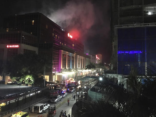 <p>Smoke rises from the Resorts World Manila complex, June 2, 2017 in Manila, Philippines. Gunshots and explosions rang out early Friday at a mall, casino and hotel complex near Manila's international airport in the Philippine capital, sparking a security alarm amid an ongoing Muslim militant siege in the country's south. (Photo: Bullit Marquez/AP) </p>