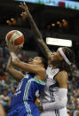 New York Liberty guard Alex Montgomery (21) tries to put the ball in the basket against Minnesota Lynx guard Seimone Augustus (33) in the first half of a WNBA basketball game, Sunday, Aug. 18, 2013, in Minneapolis. (AP Photo/Stacy Bengs)