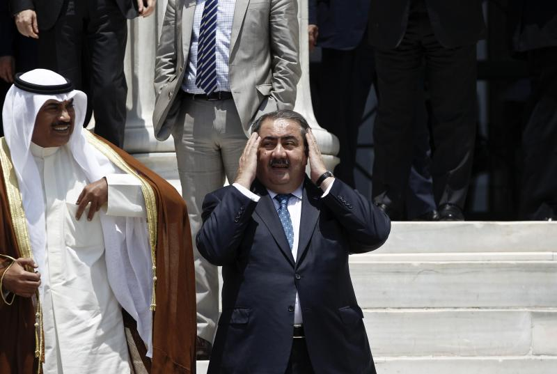 Iraqi Foreign Minister Hoshyar Zebari (C) prepares himself for a family photo during an EU-Arab league summit in Athens June 11, 2014. Baghdad will cooperate with Kurdish forces to try to drive militant out of Mosul, Iraq's foreign minister said on Wednesday, a day after an al Qaeda splinter group seized the country's second biggest city. REUTERS/Alkis Konstantinidis (GREECE - Tags: POLITICS)