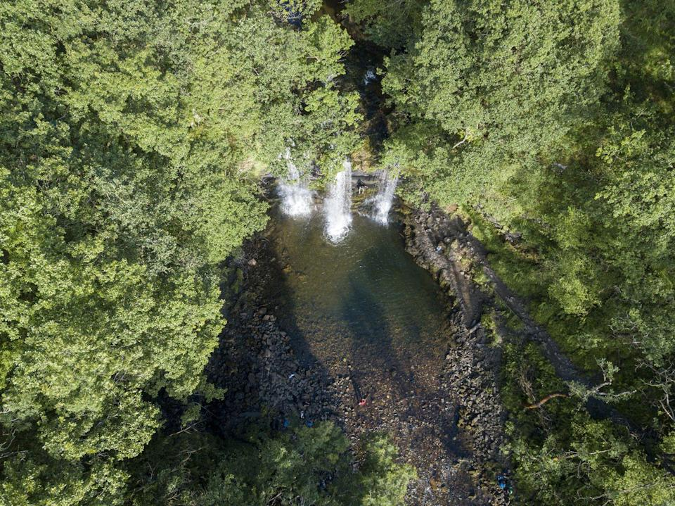 """<p><strong>Looks like: </strong>Thailand</p><p>Forget the cascading waterfalls of Thailand, Sgwd yr Eira in the Brecon Beacons is so large you can walk behind it. Welsh for 'falls of snow', this 50-foot curtain of water is part of the 'four waterfalls walk' - a three-hour trek spanning 10km. Behind the Sgwd yr Eira, icicles hang from its fringes - a truly spectacular immersion into the natural world.</p><p><strong>Stay at:</strong> Rest weary heads at <a href=""""http://www.sgwdgwladys.co.uk/"""" rel=""""nofollow noopener"""" target=""""_blank"""" data-ylk=""""slk:Sgwd Gwladys"""" class=""""link rapid-noclick-resp"""">Sgwd Gwladys</a>, a restored stone building with a cosy, welcoming atmophere. </p>"""