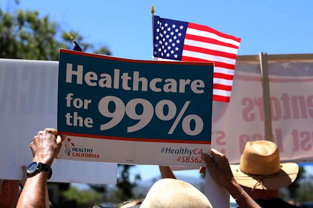 <p>Protesters demonstrate the Republican healthcare bill outside Republican Congressman Darrell Issa's office in Vista, Calif., June 27, 2017. (Photo: Mike Blake/Reuters) </p>