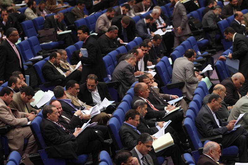 Members of Egypt's Parliament attend a session in Cairo, Egypt, Saturday, March 24, 2012. Egyptian parliamentarians on Saturday cast ballots to select a 100-member panel that will draft the country's new constitution, amid deep polarization between liberals and Islamists over the process. (AP Photo/Ahmed Gomaa)