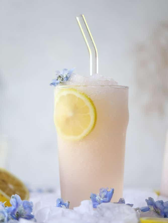 """<p>A lemonade frosé is the perfect combination of tangy, tart, refreshing, and sweet. Just blend rosé wine and lemonade for a delicious frozen slushie.</p><p><strong>Get the recipe at <a href=""""https://www.howsweeteats.com/2018/05/froze/"""" rel=""""nofollow noopener"""" target=""""_blank"""" data-ylk=""""slk:How Sweet Eats"""" class=""""link rapid-noclick-resp"""">How Sweet Eats</a>. </strong></p><p><a class=""""link rapid-noclick-resp"""" href=""""https://go.redirectingat.com?id=74968X1596630&url=https%3A%2F%2Fwww.walmart.com%2Fsearch%2F%3Fquery%3Dpioneer%2Bwoman%2Bglassware&sref=https%3A%2F%2Fwww.thepioneerwoman.com%2Ffood-cooking%2Fmeals-menus%2Fg36432840%2Ffourth-of-july-drinks%2F"""" rel=""""nofollow noopener"""" target=""""_blank"""" data-ylk=""""slk:SHOP GLASSWARE"""">SHOP GLASSWARE</a></p>"""