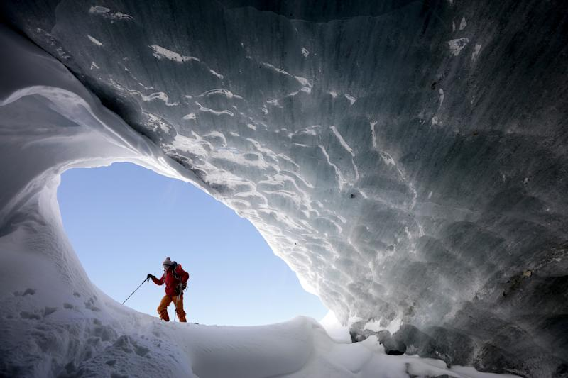 Glaciologist Andrea Fischer from the Austrian Institute for Interdisciplinary Mountain Research, walks at the entrance of an ice cave of Jamtalferner glacier near Galtuer, Austria. (Photo: Lisi Niesner/Reuters)