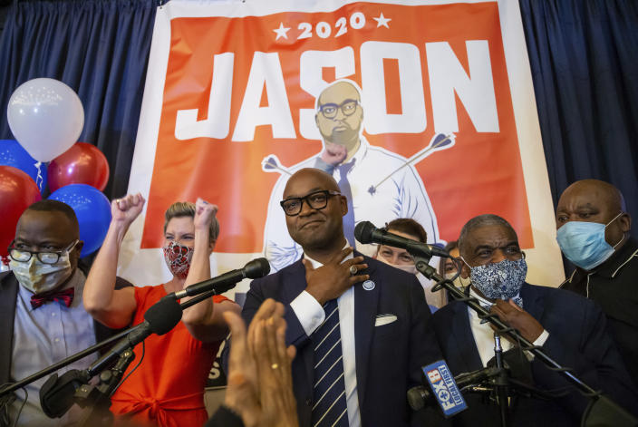 Jason Williams celebrates with supporters at NOLA Brewing Company after beating Keva Landrum in the Orleans Parish district attorney's runoff race Saturday, Dec. 5, 2020, in New Orleans. (David Grunfeld/The Advocate via AP)