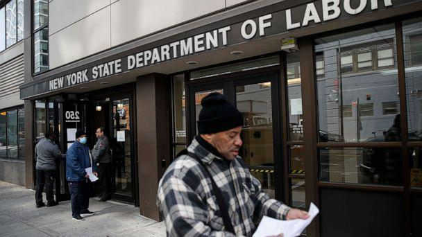 PHOTO: Visitors to the Department of Labor are turned away at the door by personnel due to closures over coronavirus concerns, Wednesday, March 18, 2020, in New York. Applications for jobless benefits are surging as coronavirus concerns shake the economy. (John Minchillo/AP)