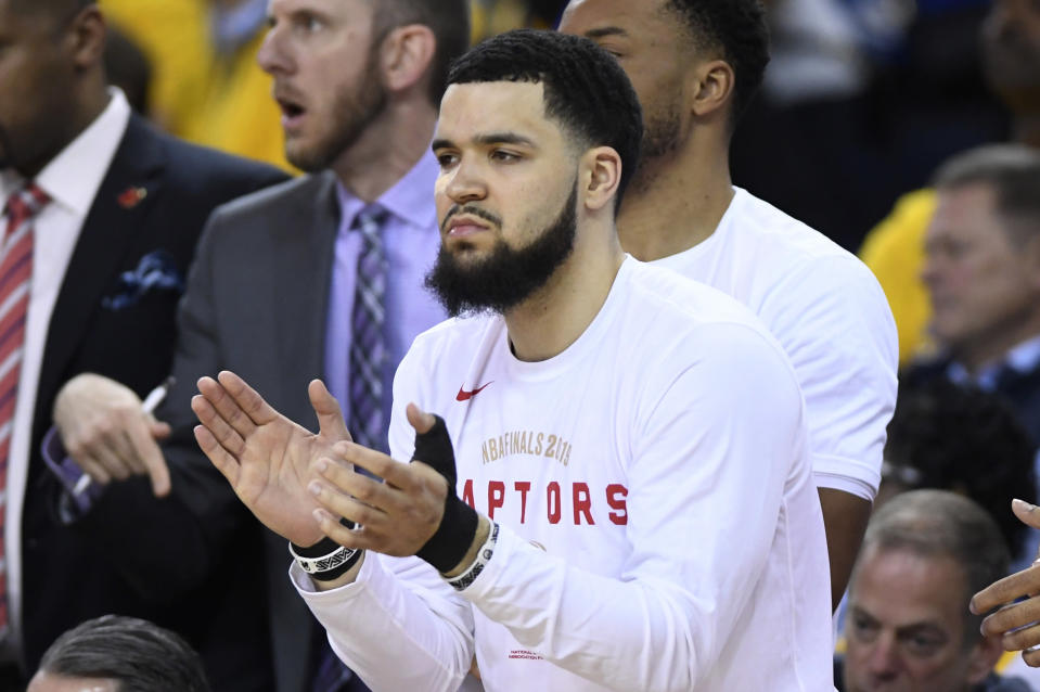 Toronto Raptors guard Fred VanVleet applauds from the bench after receiving several stitches from an elbow to the face from Golden State Warriors guard Shaun Livingston during the second half of Game 4 of basketball's NBA Finals, Friday, June 7, 2019, in Oakland, Calif. (Frank Gunn/The Canadian Press via AP)