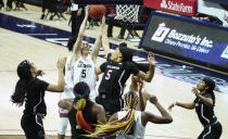 Connecticut guard Paige Bueckers (5) grabs a rebound against South Carolina forward Victaria Saxton (5) in the second half of an NCAA college basketball game in Storrs, Conn., Monday, Feb. 8, 2021. (David Butler/Pool Photo via AP)