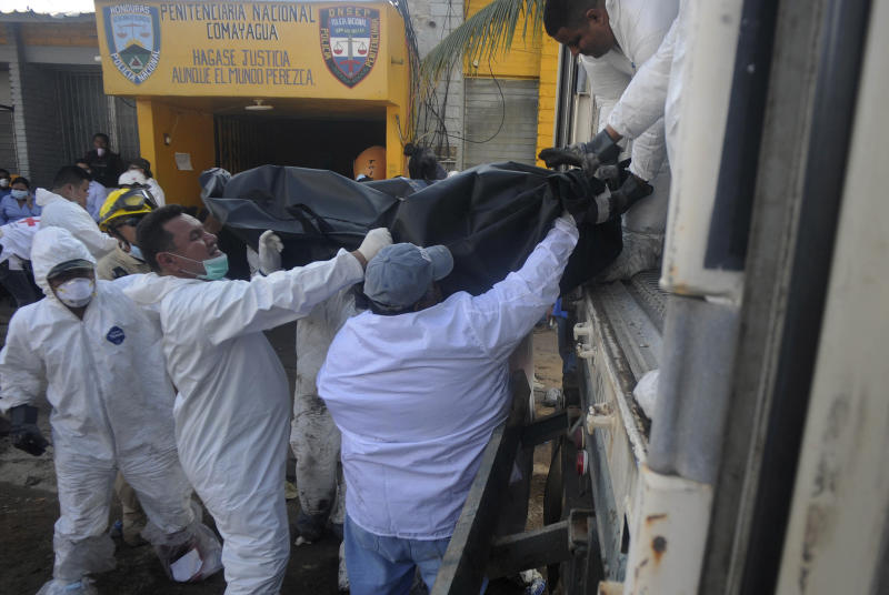 Forensic workers load into a truck bodies of inmates killed  during a fire inside the prison in Comayagua,  Honduras, Wednesday Feb. 15, 2012. Security Minister Pompeyo Bonilla said that 272 bodies have been recovered, adding that the death toll from the fire, started by an inmate late Tuesday, was likely to cross 300. (AP Photo/Fernando Antonio)