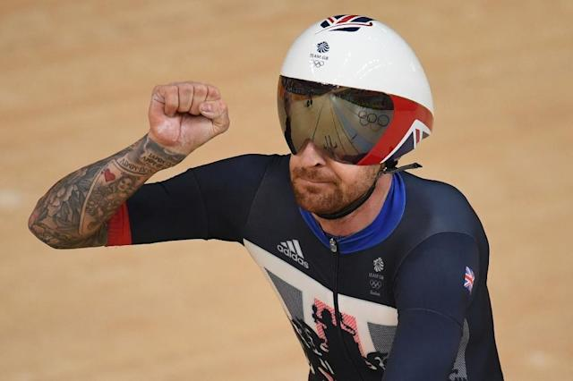 """(FILES) This file photo taken on August 12, 2016 shows Britain's Bradley Wiggins celebrating after setting a world record after competing with teammates in the men's Team Pursuit qualifying track cycling event at the Velodrome during the Rio 2016 Olympic Games in Rio de Janeiro.A 14-month investigation by United Kingdom Anti-Doping into allegations of wrongdoing at British Cycling and Team Sky has ended with no charges being brought against either organisation due to a """"lack of contemporaneous evidence"""". An inquiry was launched in September 2016 after British newspaper the Daily Mail reported a mystery package had been delivered to Richard Freeman, the doctor of now retired Tour de France winner Bradley Wiggins, then a Sky rider. (AFP Photo/Eric FEFERBERG)"""