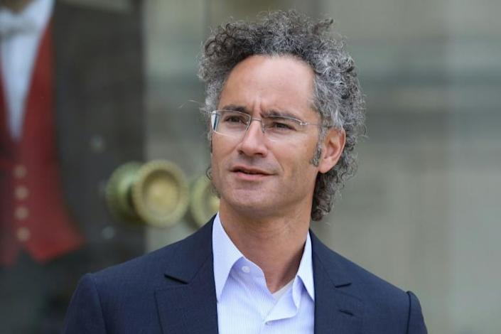 """Palantir CEO Alex Karp leaves the Elysee Palace in Paris after the """"Tech for Good"""" summit in 2018"""