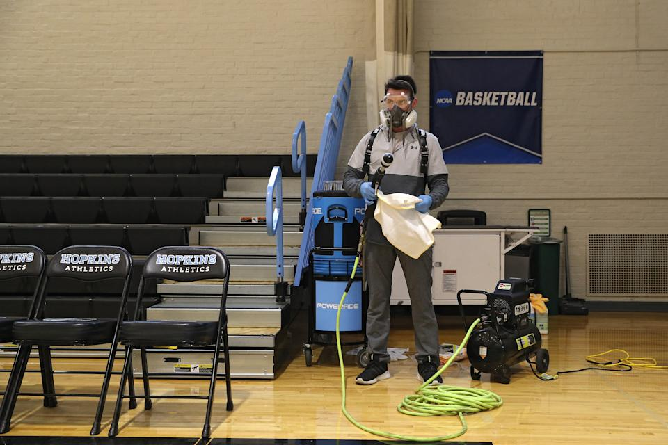 Taylor Michel, Director of Operations of DTG, Disinfecting Technologies Group, prepares to disinfect the arena following Yeshiva playing Worcester Polytechnic Institute in the NCAA Division III Men's Basketball Championship - First Round at Goldfarb Gymnasium on at Johns Hopkins University on March 6, 2020 in Baltimore, Maryland. On Thursday, Maryland Gov. Larry Hogan announced that Maryland had confirmed three cases of residents with COVID-19, otherwise known as the Coronavirus, prompting Johns Hopkins officials to host the NCAA men's basketball tournament without spectators. (Photo by Patrick Smith/Getty Images)