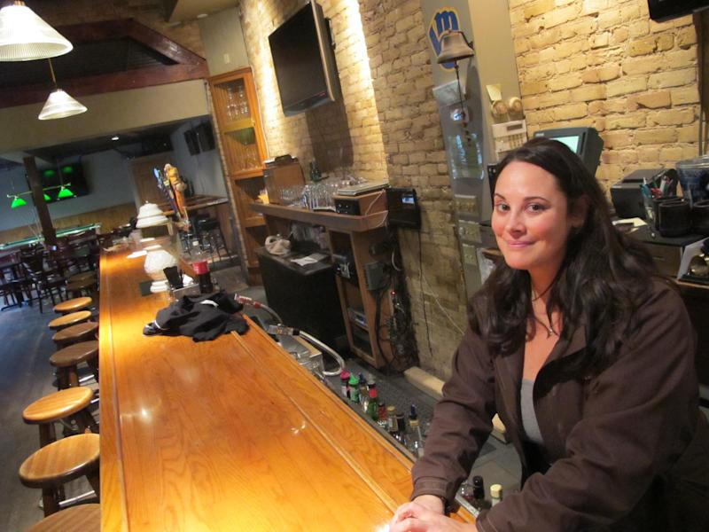 This photo taken Thursday, March 1, 2012 shows Sara Drescher, manager at 5th Ward Pub in the Walker's Point neighborhood in Milwaukee, where a marketing company is organizing a walking tour of bars where serial killer Jeffrey Dahmer hunted his victims. Drescher has mixed feelings on the subject, but some are calling it insensitive. (AP Photo/Carrie Antlfinger)