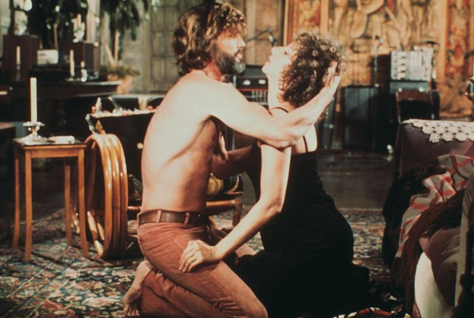 <p>Kris Kristofferson was ahead of his time, rocking colored denim in <em>A Star is Born. </em>The actor wore a pair of burnt orange, belted jeans for a romantic scene with Barbra Streisand in the iconic film. </p>