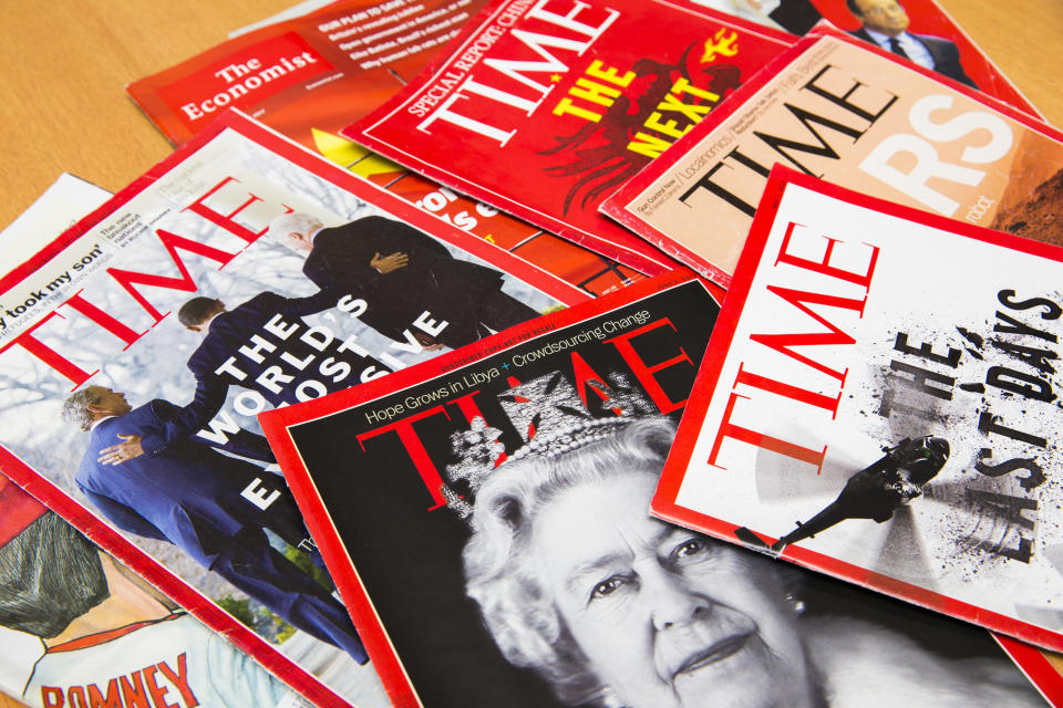 Shanghai, China - Oct 2, 2013: Popular Magazines in English language displayed, including Time and The Economist. Magazines are a great way to learn news, culture and short stories. They generate the majority of their income through advertising.