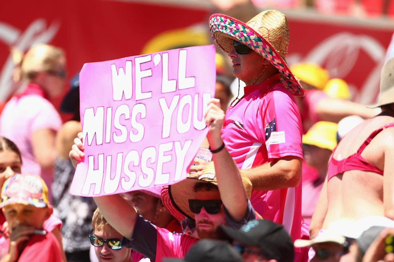 SYDNEY, AUSTRALIA - JANUARY 05:  A Michael Hussey supporter holds up a sign during day three of the Third Test match between Australia and Sri Lanka at Sydney Cricket Ground on January 5, 2013 in Sydney, Australia.  (Photo by Mark Kolbe/Getty Images)