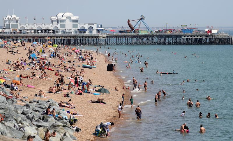 Meanwhile, sunbathers lapped up the rays again in Southsea, Hampshire. (PA)
