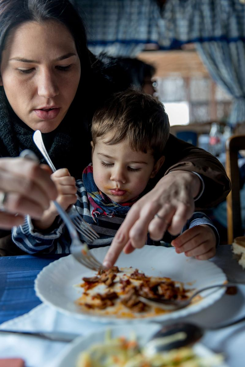 How Can I Stop Eating Like a Maniac in Front of My Son?