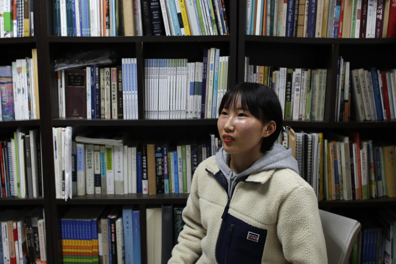 In this Nov. 6, 2019, photo, Song Hong Ryon speaks during an interview in Uijeongbu, South Korea. Song Hong Ryon looks like any other young woman in South Korea. But three years after her arrival from China, the half-North Korean, half-Chinese 19-year-old has made only two South Korean-born friends and says she's often been hurt by little things, like when people ask if she's from China because of her accent.(AP Photo/Lee Jin-man)