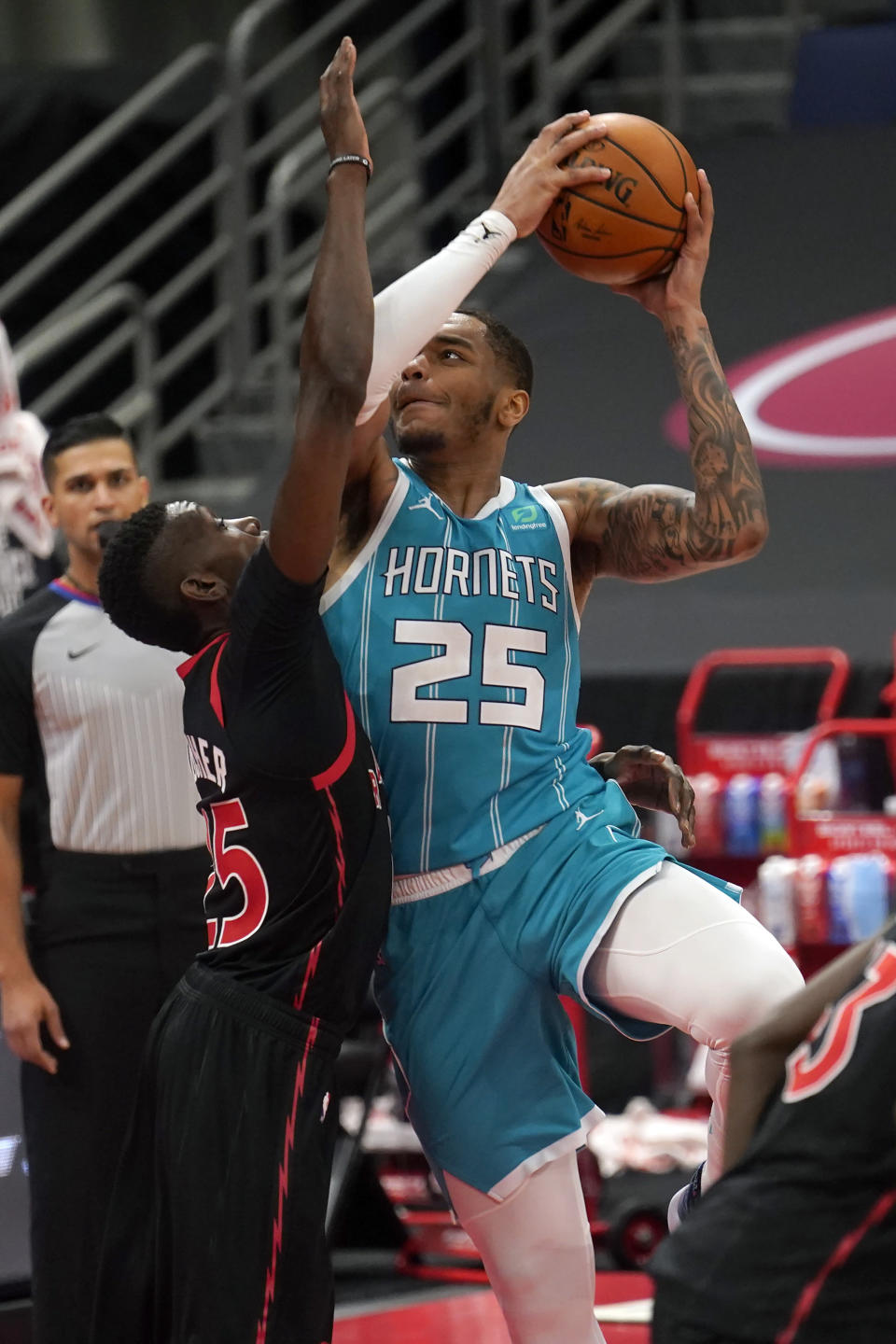 Charlotte Hornets forward P.J. Washington (25) shoots over Toronto Raptors forward Chris Boucher during the second half of an NBA basketball game Saturday, Jan. 16, 2021, in Tampa, Fla. (AP Photo/Chris O'Meara)