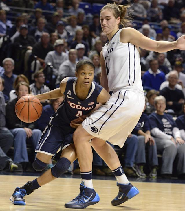 Connecticut's Moriah Jefferson (4) drives to the basket past Penn State's Tori Waldner, right, during the first half of an NCAA college basketball game, Sunday, Nov. 17, 2013, in State College, Pa. (AP Photo/John Beale)