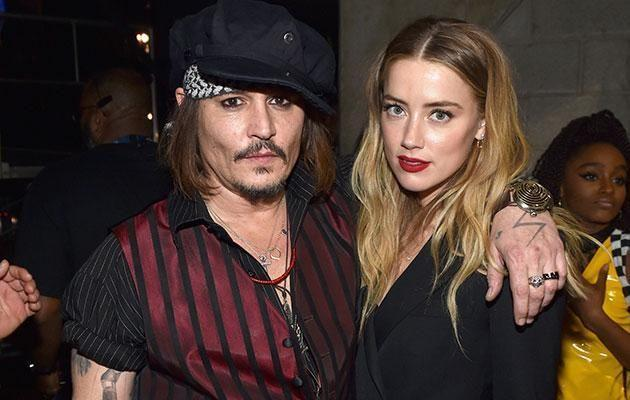 Johnny and Amber. Source: Getty