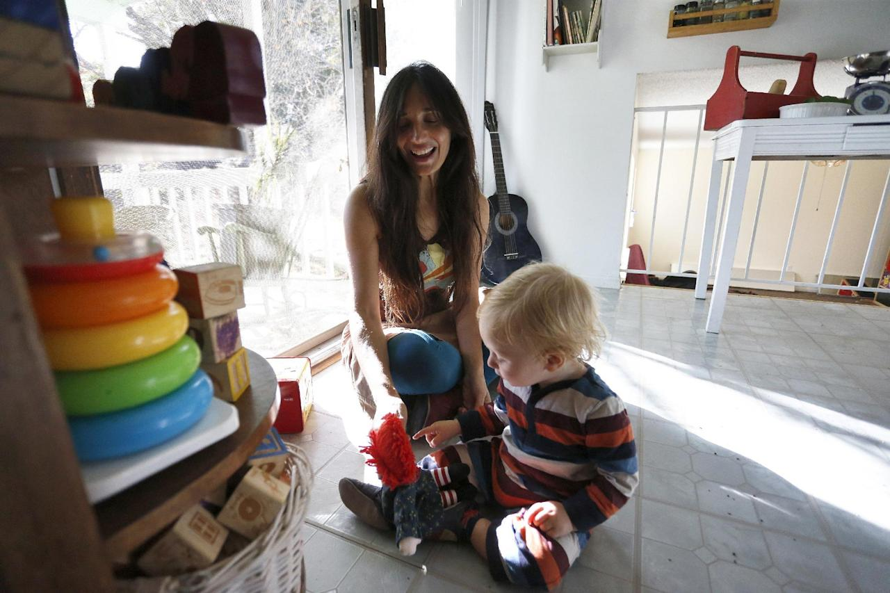 In this Thursday, Oct. 20, 2016 photo, vegan mother Fulvia Serra plays with her 1-year-old baby Sebastiano, at home in Fort Collins, Colo. Serra, originally from Italy, and her husband, Scott, are raising their son vegan. Despite criticism and innuendo from some circles, pediatricians and nutritionists agree it's perfectly healthy to feed babies a vegan diet. However, parents need to be well-informed about the nutritional elements different foods offer, and work closely with their doctor or health care provider. (AP Photo/Brennan Linsley)