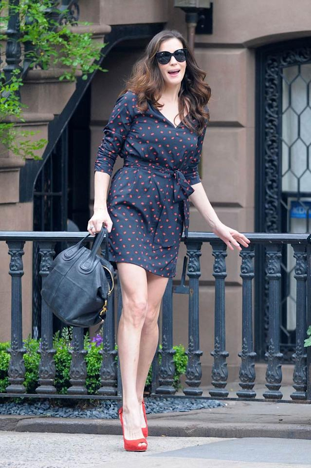 """No, this isn't the best picture of Liv Tyler. Give her (and me!) a break; it's a candid paparazzi shot. Anyway, I wanted to take a quick break from all the glam gowns to feature a really cool, casual look. Is it just me, or is her $325 DKNY dress not the cutest thing ever? And, yes, I'm also loving her red Louboutin peep-toes and black leather Givenchy Nightingale bag. Thoughts? <a href=""""http://www.pacificcoastnews.com/"""" target=""""new"""">PacificCoastNews.com</a> - June 21, 2011"""