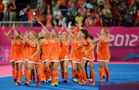 LONDON, ENGLAND - AUGUST 10:  Team Netherlands celebrate their 2-0 victory over team Argentina as they walk off the field after the Women's Hockey gold medal match on Day 14 of the London 2012 Olympic Games at Hockey Centre on August 10, 2012 in London, England.  (Photo by Mike Hewitt/Getty Images)