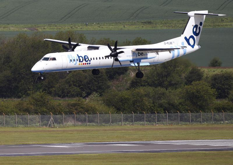 A Flybe aircraft lands at Edinburgh Airport in Scotland