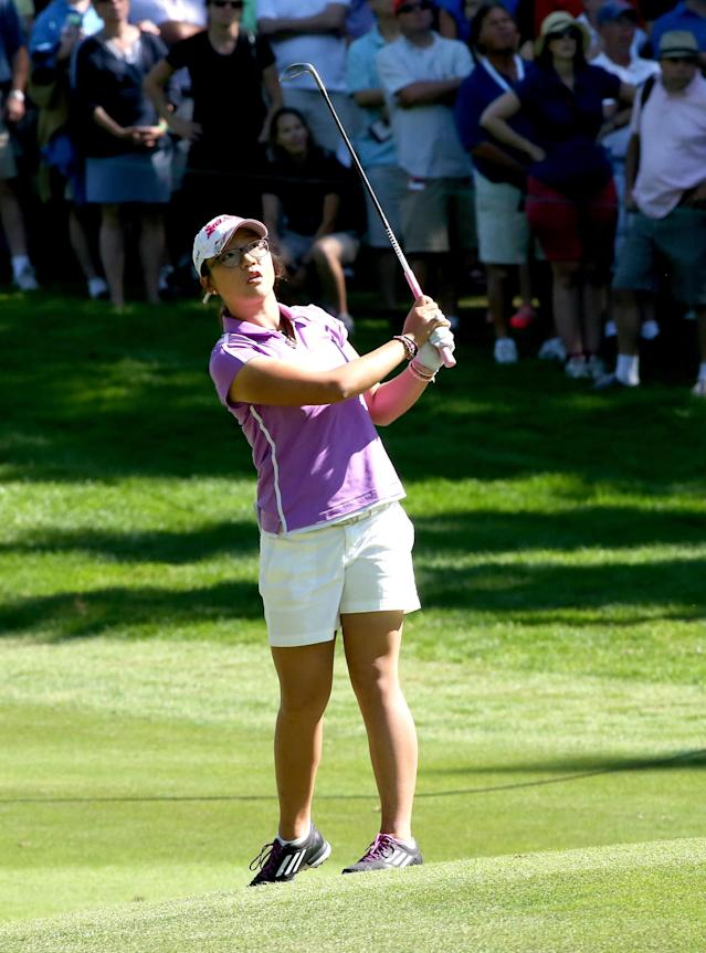 EDMONTON, AB - AUGUST 25: Lydia Ko of New Zealand hits her second shot on the 15th hole during the final round of the CN Canadian Women's Open at Royal Mayfair Golf Club on August 25, 2013 in Edmonton, Alberta, Canada. (Photo by Stephen Dunn/Getty Images)