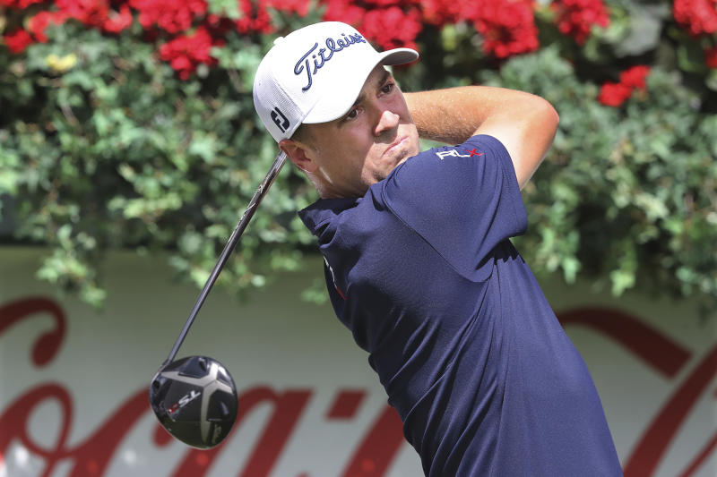Justin Thomas tees off on the first hole during practice for the Tour Championship golf tournament in Atlanta, Wednesday, Aug. 21, 2019.  (Curtis Compton/Atlanta Journal-Constitution via AP)