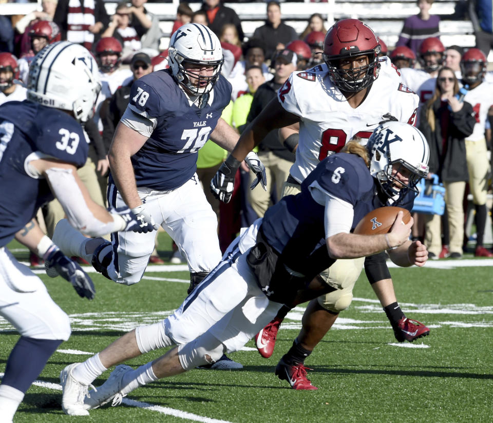 Yale quarterback Kurt Rawlings attempts to get a first down against Harvard during the first half during an NCAA college football game, Saturday, Nov. 23, 2019, in New Haven, Conn. (Arnold Gold/New Haven Register via AP)