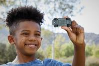A child plays with a die-cast car
