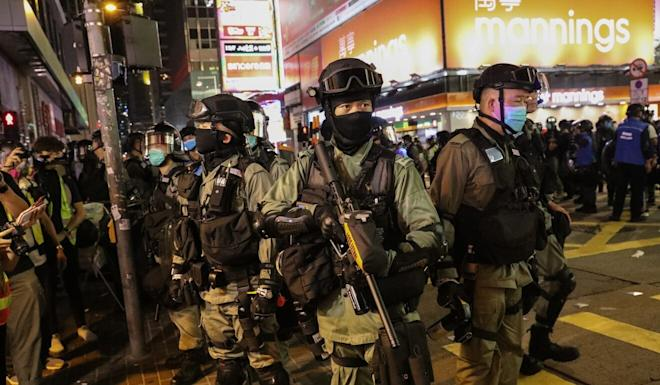 Riot police in Mong Kok during a demonstration on Wednesday against the national anthem and national security laws. Photo: Sam Tsang