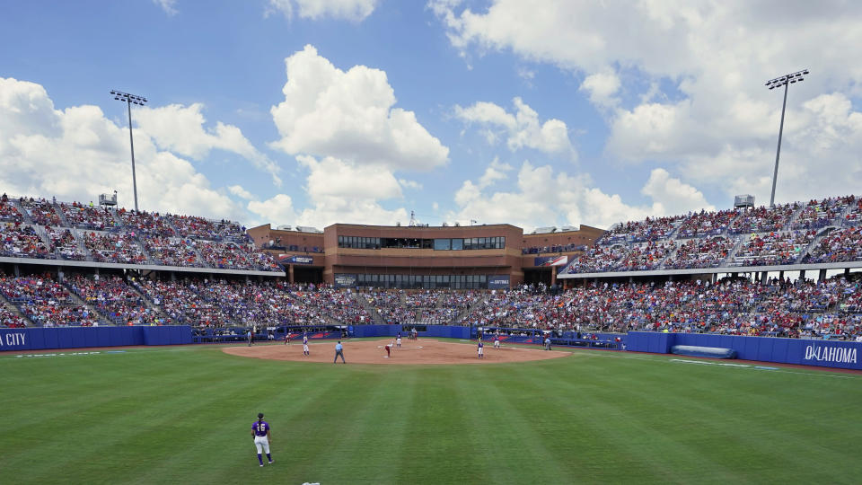 FILE - In this June 3, 2021, file photo, No. 1-seeded Oklahoma faces James Madison in the first game of the Women's College World Series in the revamped USA Softball Hall of Fame Complex in Oklahoma City. Recent improvements to the stadium included the addition of 4,000 seats. (AP Photo/Sue Ogrocki, File)