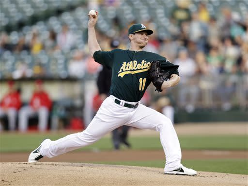 Oakland Athletics starting pitcher Jarrod Parker throws to the Los Angeles Angels during the first inning of a baseball game, Tuesday, April 30, 2013, in Oakland, Calif. (AP Photo/Marcio Jose Sanchez)