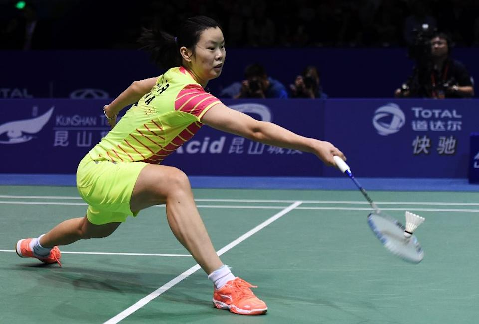 Li Xuerui of China hits a return against Natalia Koch Rohde of Denmark during their women's singles group match in the Uber Cup badminton tournament in Kunshan, eastern China's Jiangsu Province on May 18, 2016 (AFP Photo/Johannes Eisele)