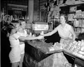 """<p>Two girls attempt to devour the """"10,000 Calorie Sundae,"""" available for a mere 35 cents, from an ice cream parlor in Lynchburg, Virginia. <br></p>"""