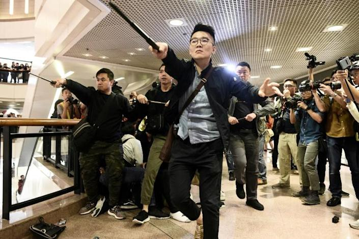 Flashmob rallies were held in multiple malls across the financial hub (AFP Photo/Philip FONG)