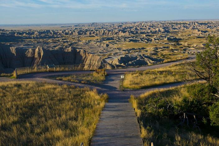 <p>The walking trail loops down to a scenic overlook at the Badlands National Park, South Dakota. // October 18, 2015</p>