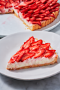 """<p>Nothing says spring quite like this easy strawberry tart. The crust is a simple no-chill version of a pie crust that we are obsessed with. The filling is a sweet cream cheese with a hint of lemon that makes the <a href=""""https://www.delish.com/uk/cooking/recipes/a31954937/chocolate-strawberry-cake/"""" rel=""""nofollow noopener"""" target=""""_blank"""" data-ylk=""""slk:strawberries"""" class=""""link rapid-noclick-resp"""">strawberries</a> pop. We will be making it all season long! </p><p>Get the <a href=""""https://www.delish.com/uk/cooking/recipes/a32484927/strawberry-tart-recipe/"""" rel=""""nofollow noopener"""" target=""""_blank"""" data-ylk=""""slk:Strawberry Tart"""" class=""""link rapid-noclick-resp"""">Strawberry Tart</a> recipe.</p>"""
