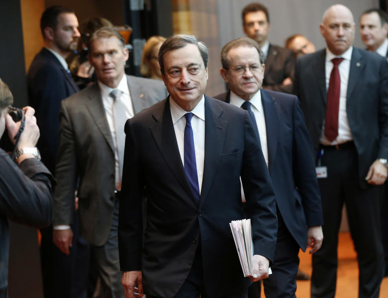 President of European Central Bank, ECB, Mario Draghi is on his way to a news conference in Frankfurt, Germany, Thursday, Dec. 5, 2013, following a meeting of the ECB governing council. The European Central Bank has cut its inflation forecast for next year, another sign of how weak the economic recovery is in the 17 countries that use the euro. The ECB cut the forecast to 1.1 percent from the previous 1.3 percent forecast. (AP Photo/Michael Probst)