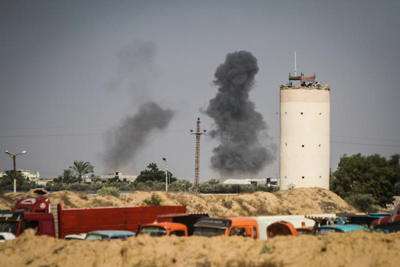 Seen across the Egyptian Rafah border with Israel, smoke ascends as Israeli artillery and air force pound the Palestinian Gaza Strip on July 19, 2014 (AFP Photo/Mohamed el-Shahed)