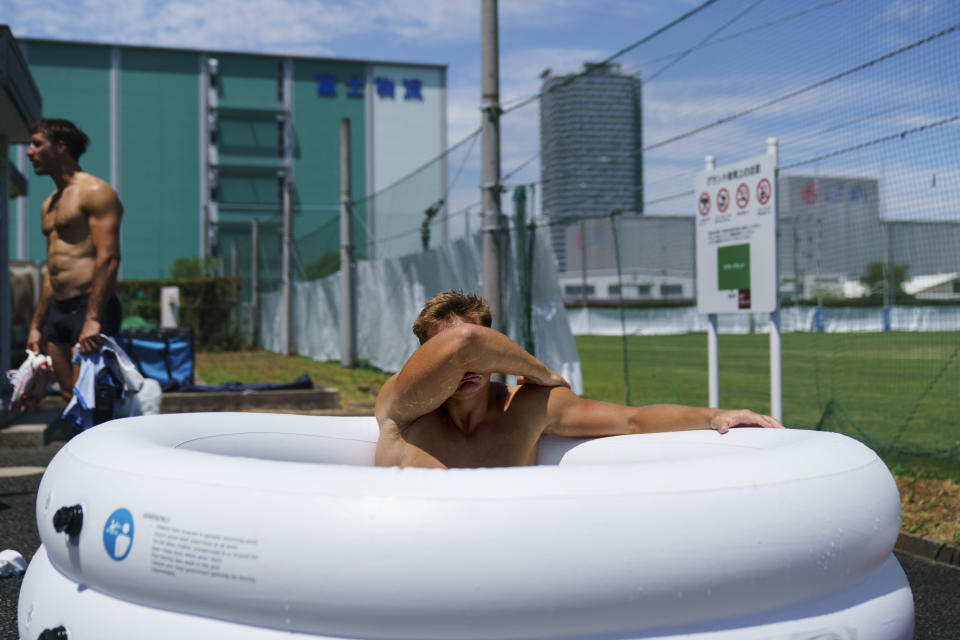 Argentina's Santiago Mare soaks in an ice bath following a men's rugby sevens practice at the Tokyo 2020 Olympics, in Tokyo, Friday, July 23, 2021. (AP Photo/David Goldman)